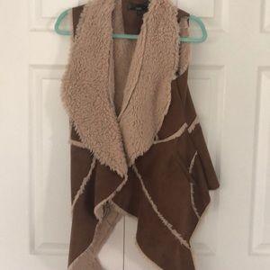 Sheepskin flyaway vest with clip to close
